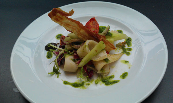 Pan fried squid with Mediterranean salad and crispy pancetta