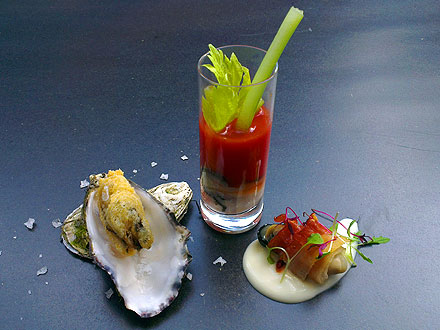 Oysters 3 Ways - Oyster Tempura, Bloody Mary Oyster Shot, Oyster Wrapped in Pancetta with a Cheese Sauce.