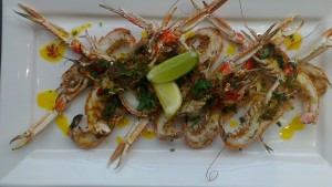 After grilling  the langoustines, serve with a drizzle of Moroccan butter and garnish with lime.