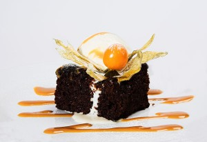 Warm Sticky Date Pudding with Cream and Butterscotch Sauce