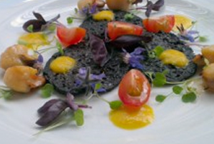 Grilled Queen Scallops on Black Pudding Wafers with Viola Petals and Yellow Pepper Dressing