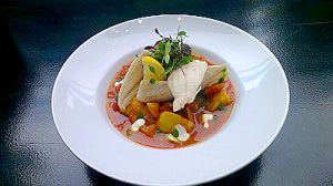 Grilled Haddock Fillet on a Curried Vegetable Stew Topped with Creme Fraiche