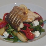 Fillet of Sea Bass with Roasted Red Peppers, Feta, New Potato and Rocket Salad.