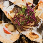 Try our famous Seafood Platter including queen scallops, king scallops, tiger prawns, mussels and sea bass