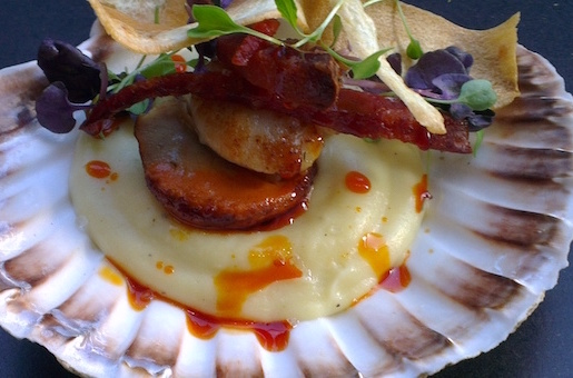 King Scallops in the shell with parsnip puree, chorizo sausage and parsnip crisps close up