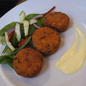 Mussel Inn fish cakes with mixed leaves served with a light lemon and saffron mayonnaise